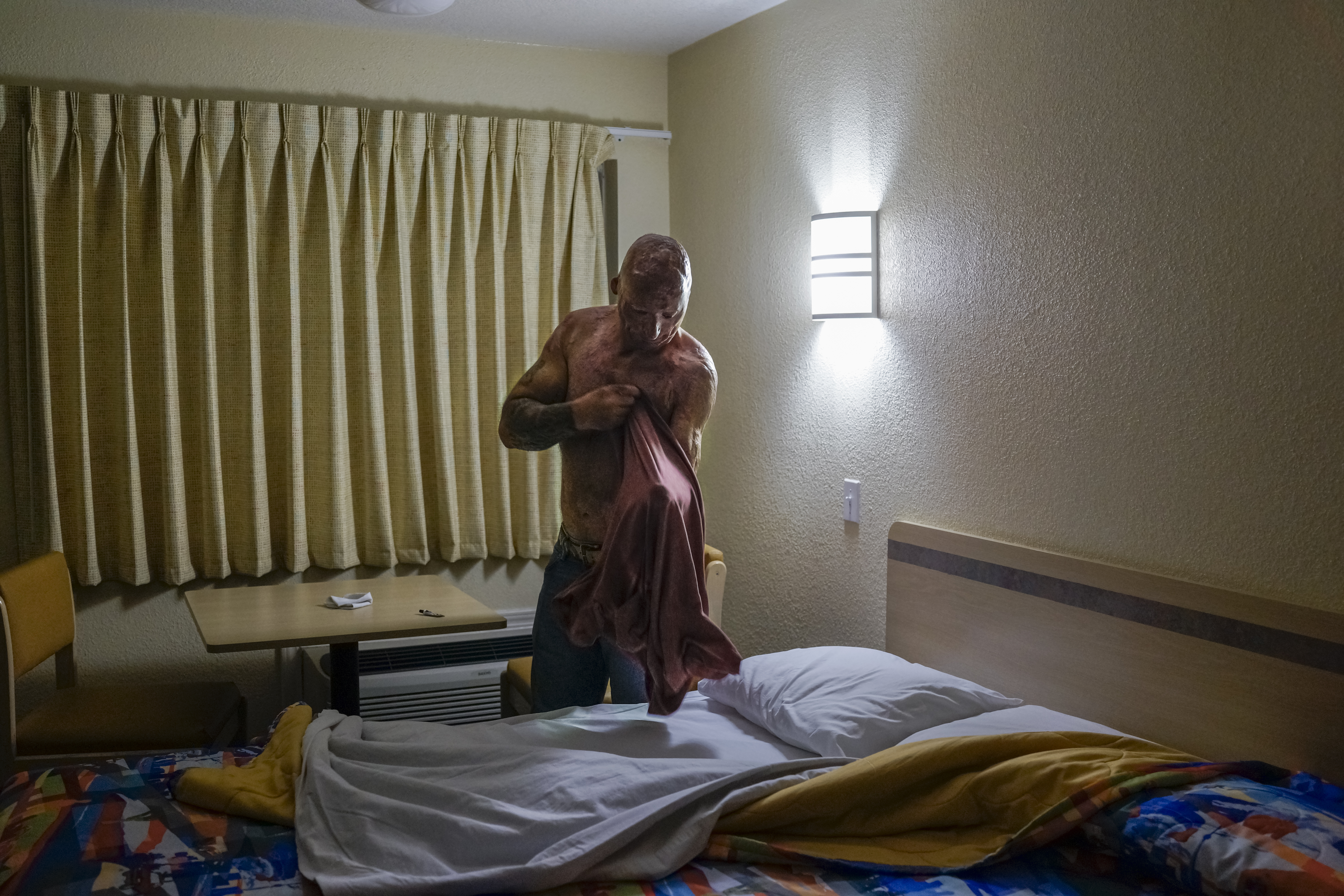 Bobby gets ready for bed at a Motel 6 in Humble, Texas, 2013.