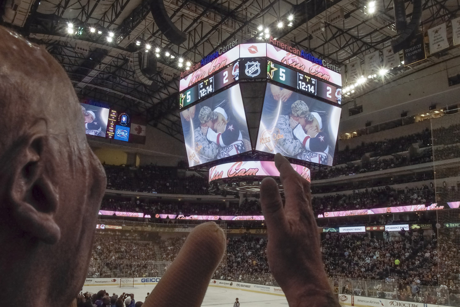 Bobby applauds a soldier at a Dallas Stars hockey game who just returned stateside from a deployment to Afghanistan. 2013.