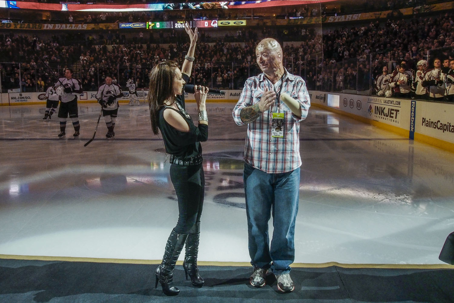 Bobby on ice with singer Celine Ray after the national anthem. He was the center of Military Appreciation night for the Dallas Stars NHL team. 2013.