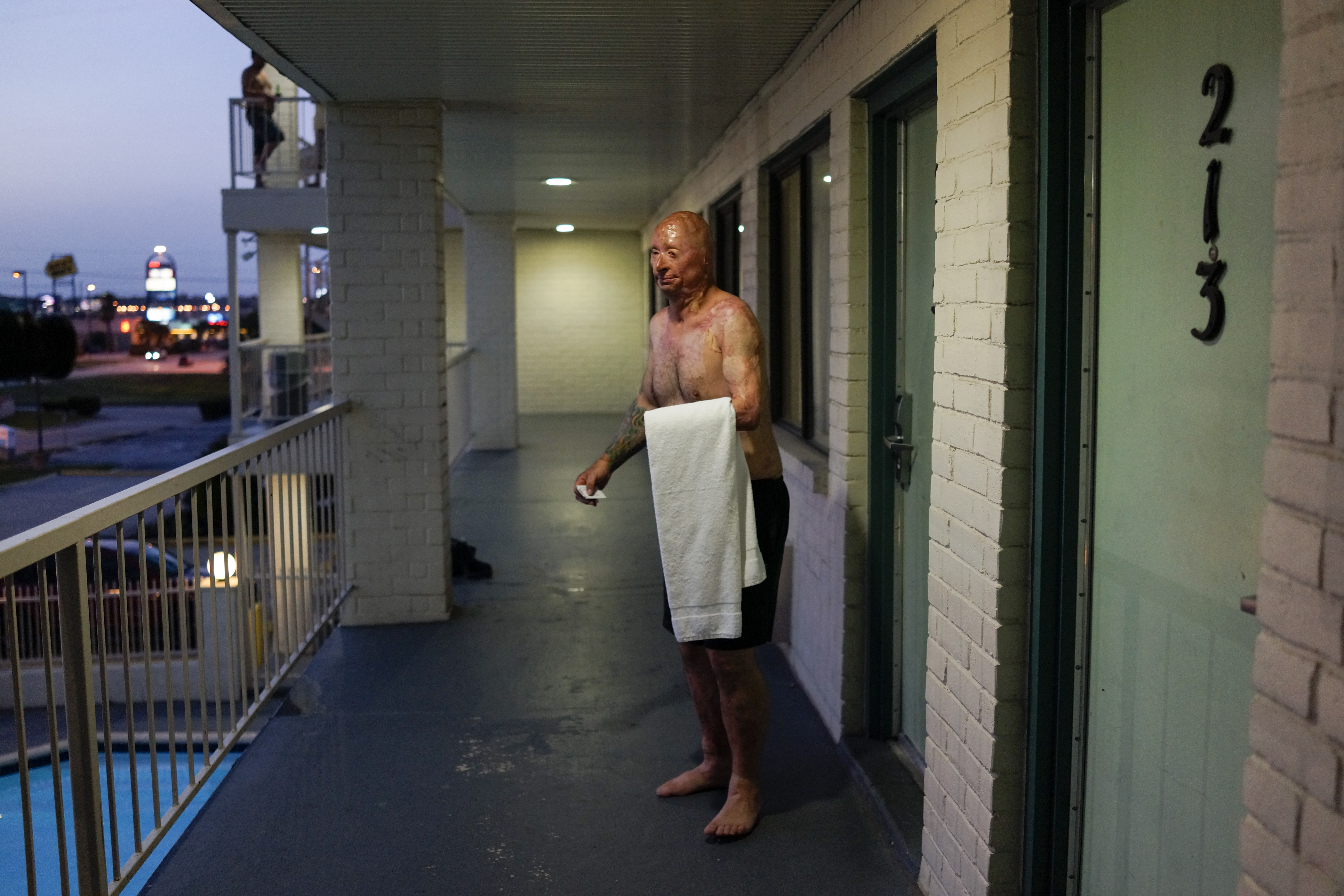 After visiting Rodney's father, Bobby takes a swim in his hotel in Humble, Texas. 2013.