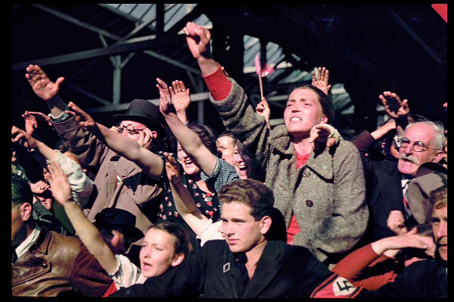 Austrians cheer Adolf Hitler during his 1938 campaign (before the Anschluss)  to unite Austria and Germany.