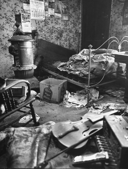 The filthy, cluttered bedroom in Ed Gein's Plainfield, Wis., home, 1957.