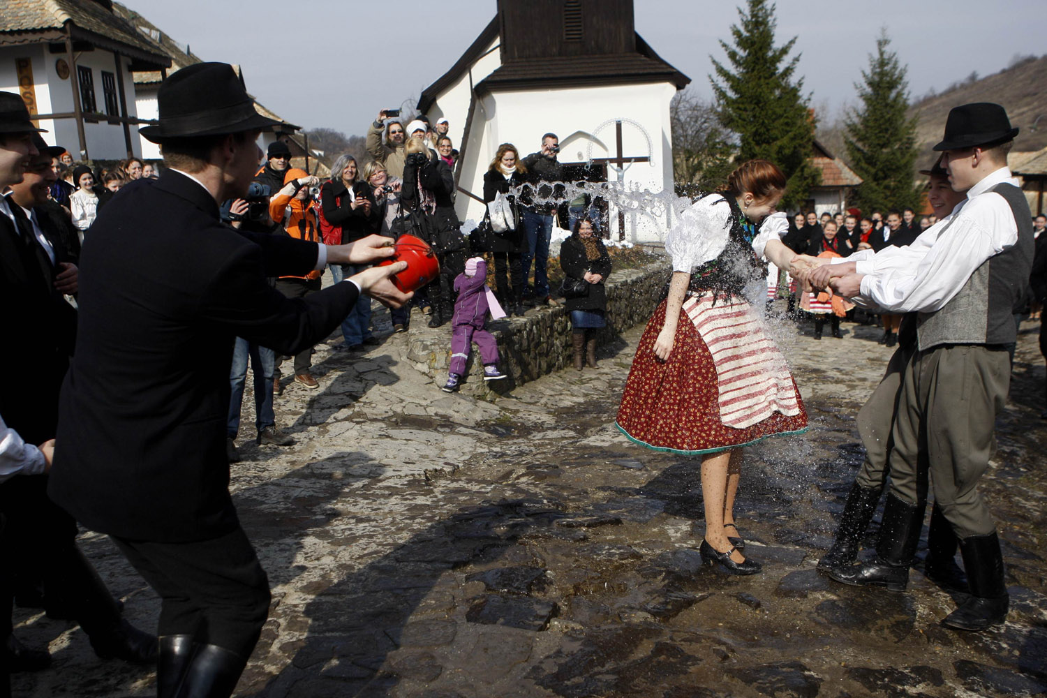 April 1, 2013. A man throws water on a woman as part of traditional Easter celebrations in Holloko, 100 km (62 miles) east of Budapest.