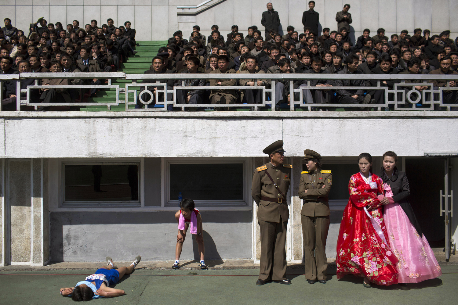 April 14, 2013. Runners rest inside Kim Il Sung Stadium in Pyongyang, North Korea.
