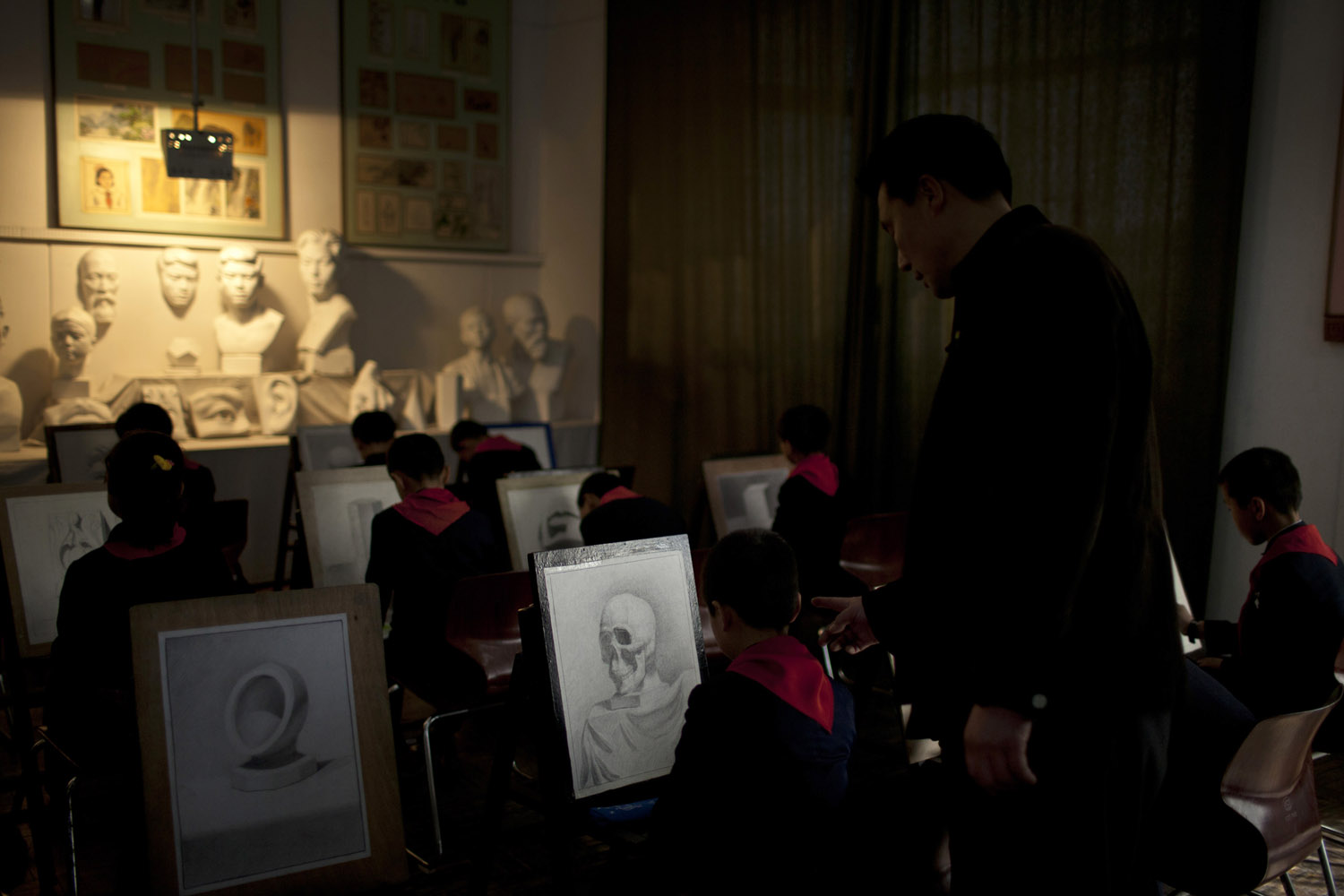 April 18, 2013. A teacher instructs during a drawing class at Mangyongdae Children's Palace in Pyongyang, North Korea.