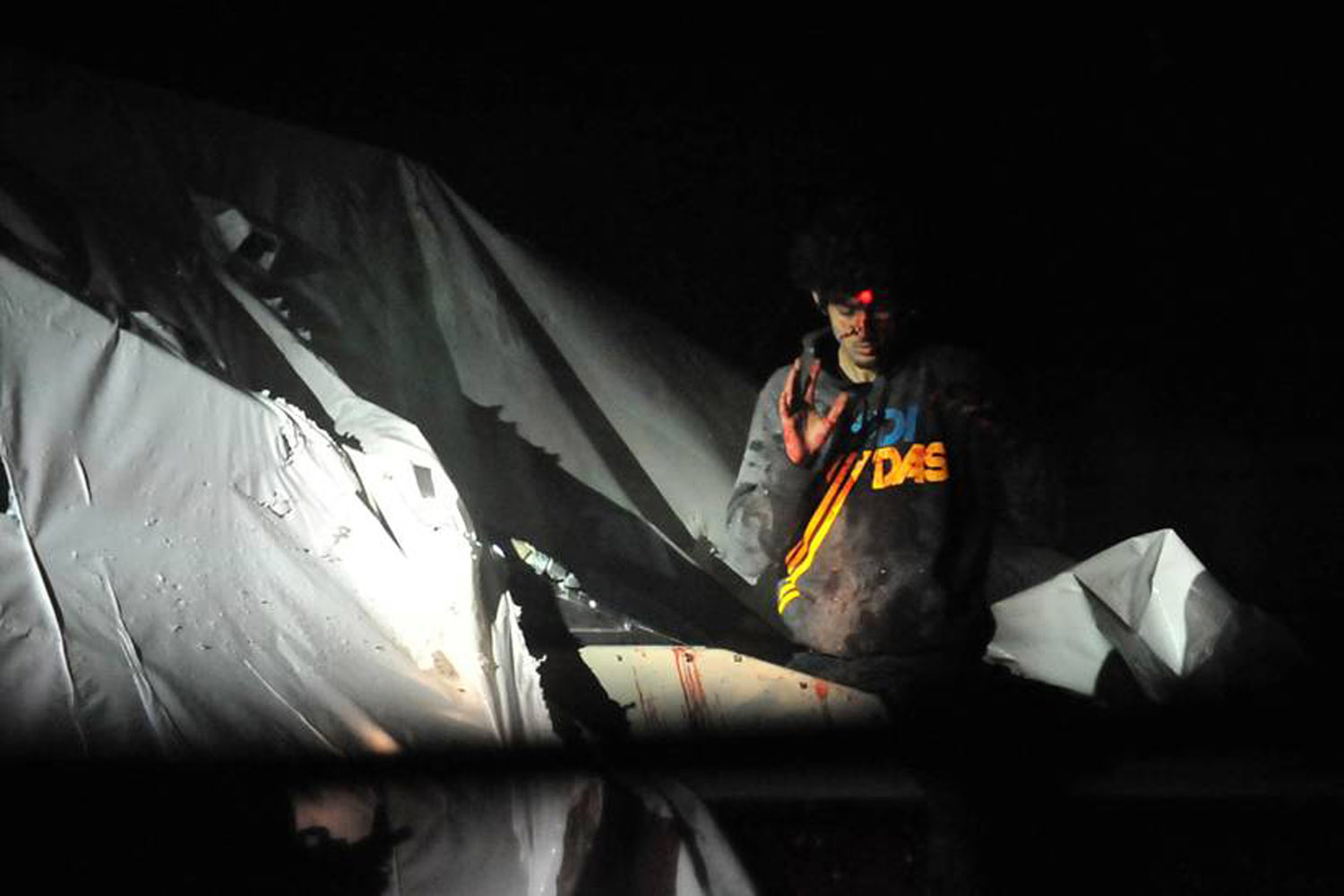 April 19, 2013. Accused  Boston Bomber  Dzhokhar Tsarnaev is shown before his arrest with a sniper's laser sight trained on his head as he surrenders to authorities after a massive manhunt.