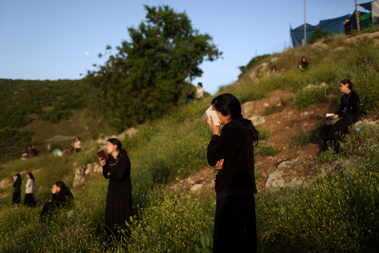 April 28, 2013. Ultra-Orthodox Jewish women pray on Mount Meron during the Jewish holiday of Lag Baomer near the grave site of Rabbi Shimon Bar Yochai in the northern Israeli village of Meron.