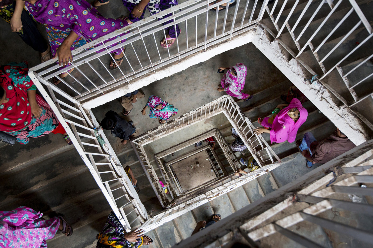 April 29, 2013. Workers leave for their lunch break in a building that houses garment factories in Dhaka, Bangladesh.