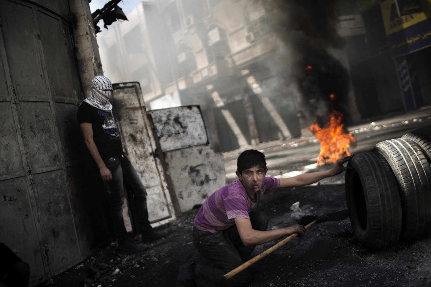 April 3, 2013. A Palestinian demonstrator looks on during clashes with the Israeli army in the West Bank city of Hebron.