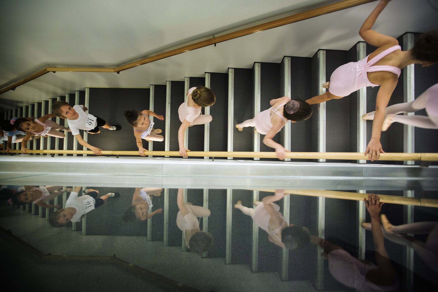 April 5, 2013. Young ballet dancers climb a staircase to take part in auditions for six-year-olds at the School of American Ballet (SAB) at Lincoln Center in New York.