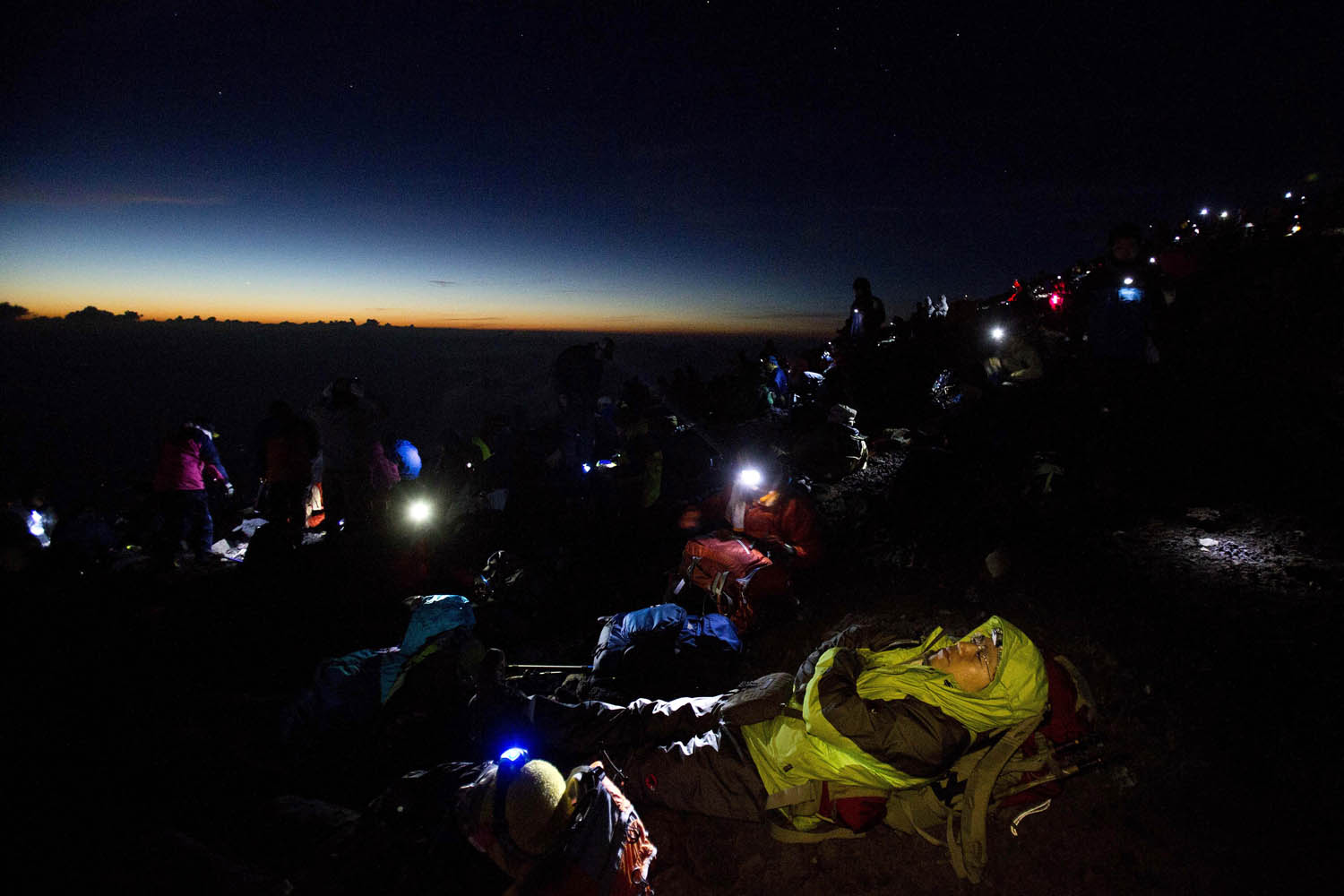 Aug. 11, 2013. Thousands of hikers wait for the sun to rise on the summit of Mount Fuji before dawn.