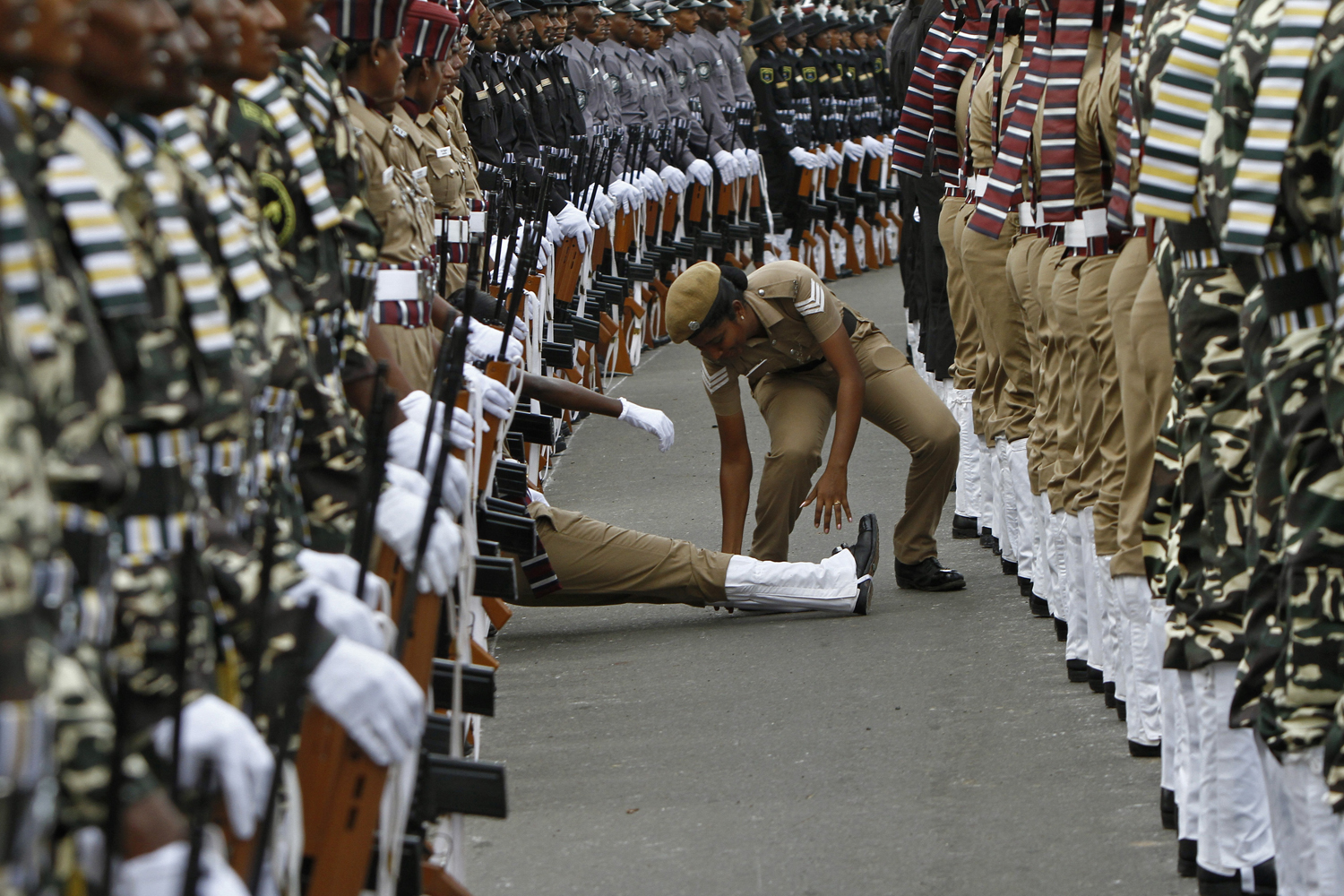 Aug. 13, 2013. An Indian policewoman helps her comrade who fainted during the full-dress rehearsal for India's Independence Day celebrations in the southern Indian city of Chennai.