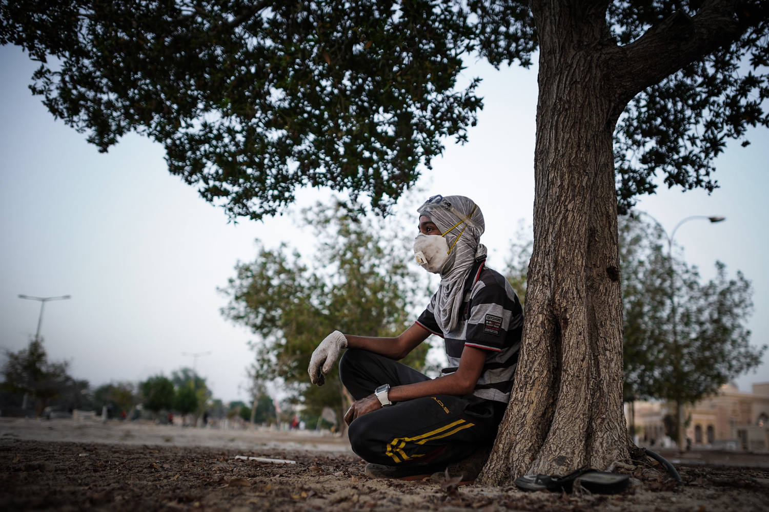 Aug. 15, 2013. A Bahraini protestor sits next to a tree to rest during the clashes with riot police following an anti-regime protest in the village of Abu Saiba, west of Manama.