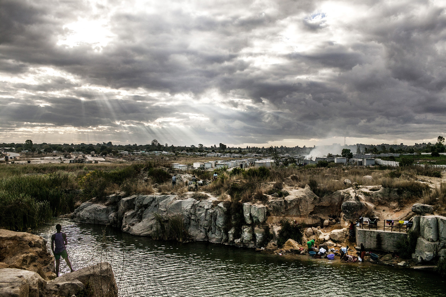 Aug. 2, 2013. People at a quarry in Epworth, a suburb in Harare, Zimbabwe.