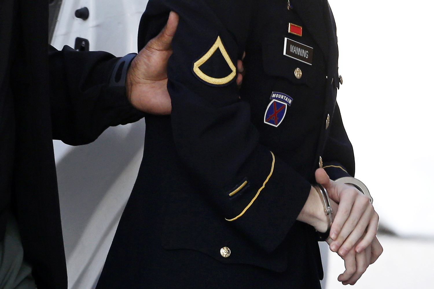 Aug. 20, 2013. Army Pfc. Bradley Manning is escorted into a courthouse in Fort Meade, Md., before a hearing in his court martial.