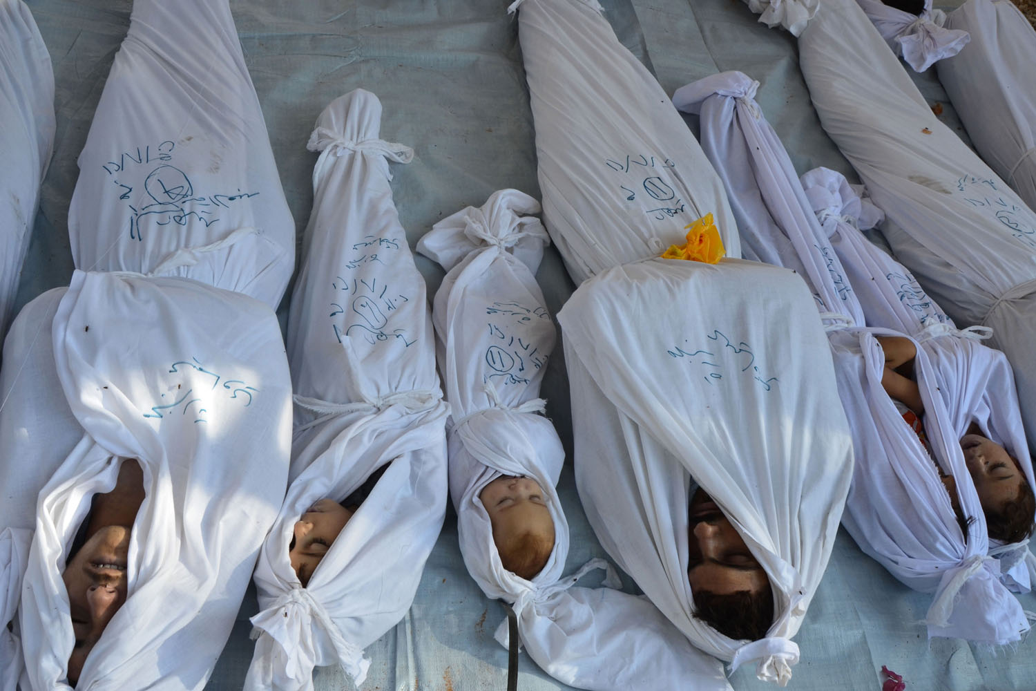 Aug. 21, 2013. Bodies of people activists say were killed by nerve gas in the Ghouta region are seen in the Duma neighbourhood of Damascus, Syria.