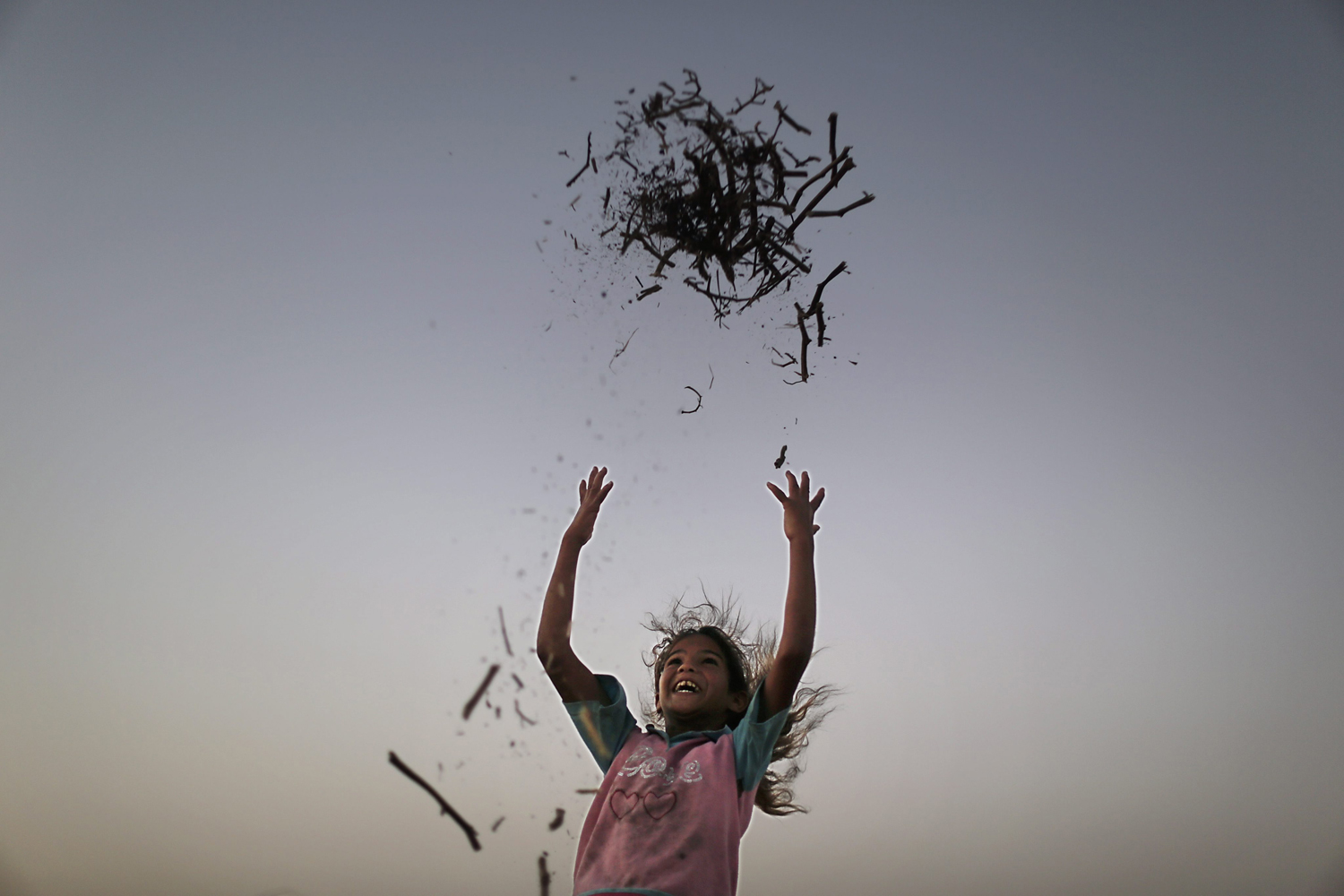Aug. 27, 2013. A Palestinian girl play outside her family's tent in a poverty-stricken quarter of the town of Younis, in the southern Gaza Strip.