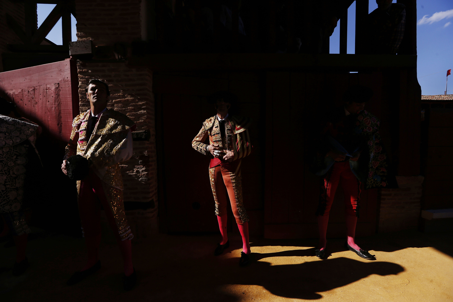 Aug. 28, 2013. Spanish bullfighter David Mora, left, and Juan Jose Padilla wait to do the paseillo or ritual entrance to the arena before a bullfight, in Toro, Spain.
