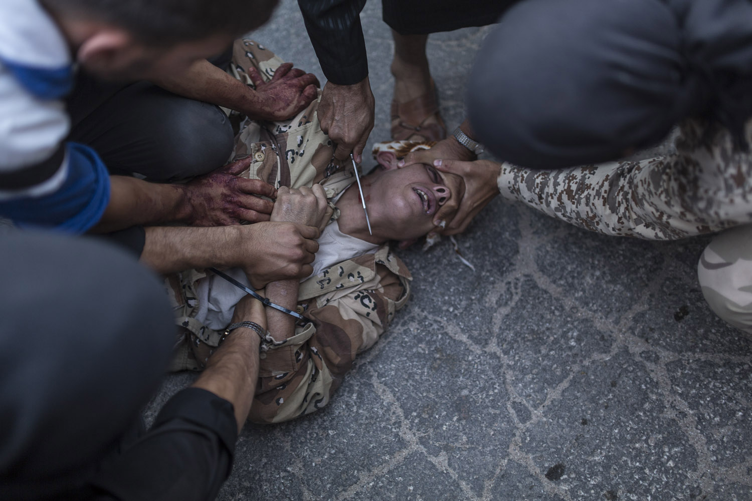 Aug. 31, 2013. A young Syrian man is executed by anti-regime rebels in the town of Keferghan, near Aleppo.
