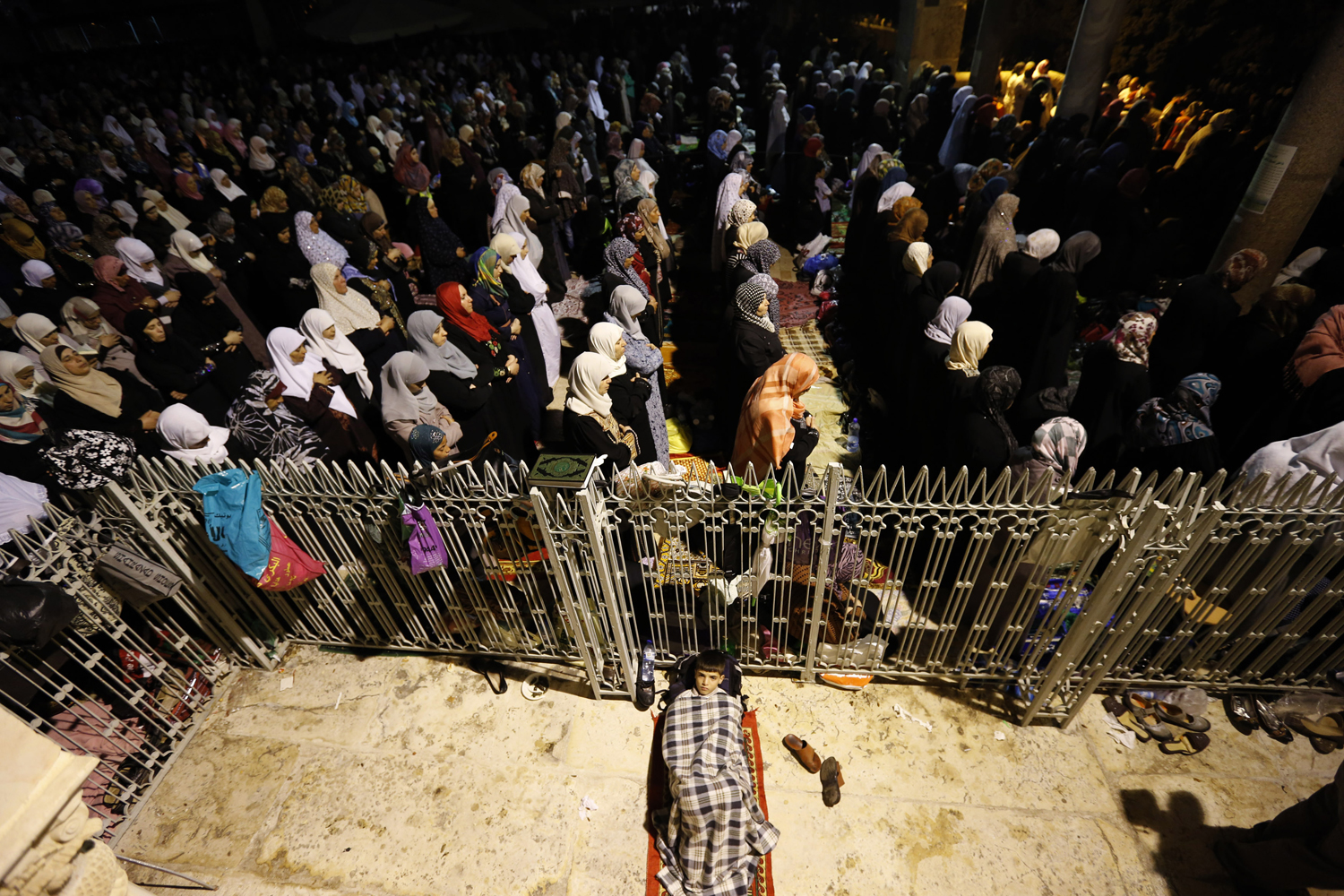 Aug. 4, 2013. Female Palestinian worshippers pray in front of the Dome of the Rock, in the Al Aqsa Mosque compound in Jerusalem, during Lailat-Al-Qadr, or Night of Power, in which the Muslim Holy book of Koran was revealed to Prophet Mohammad by Allah.