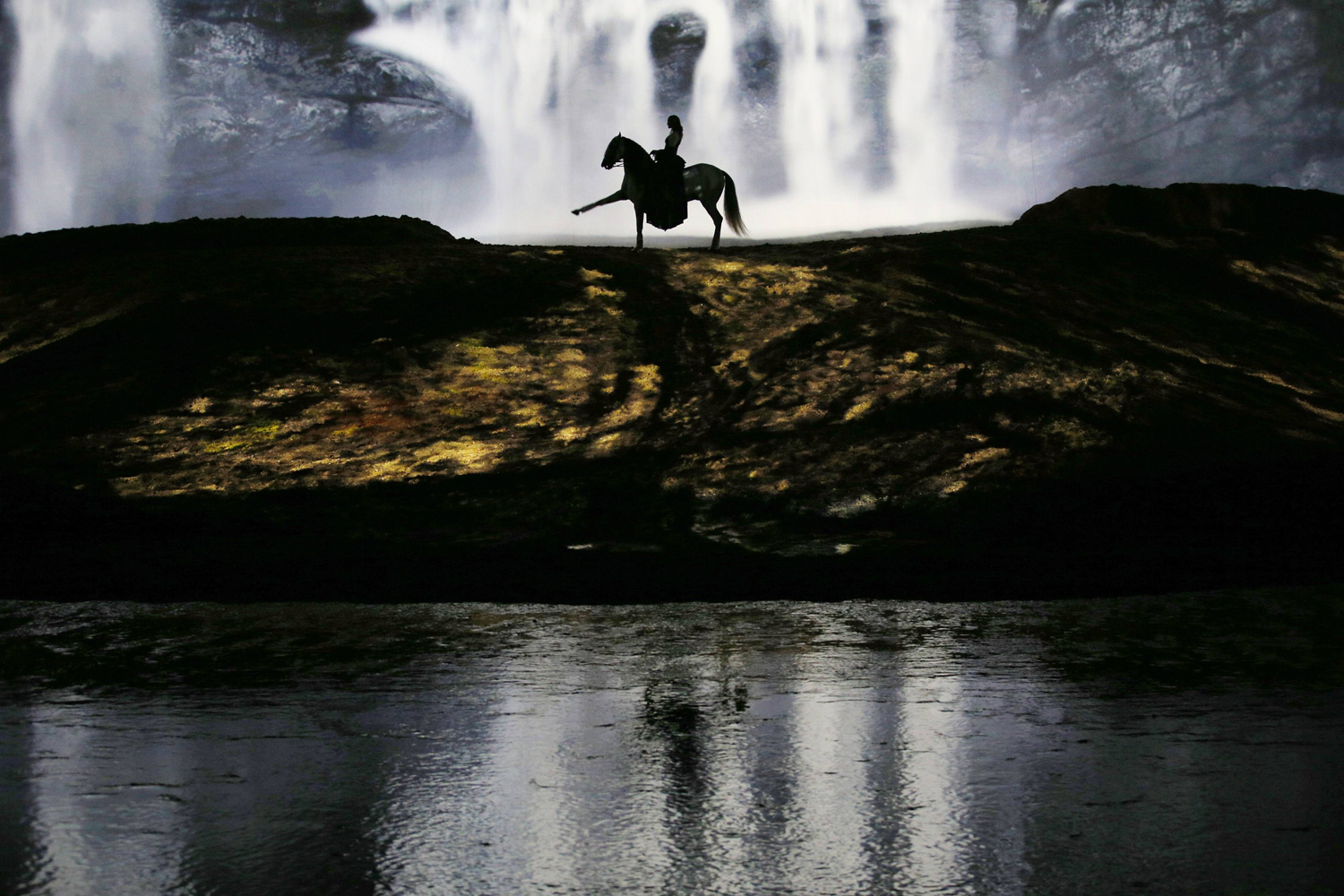 Aug. 6, 2013. A horse and rider perform during a  sneak peek  performance of Cavalia's show  Odysseo  in Somerville, Mass.