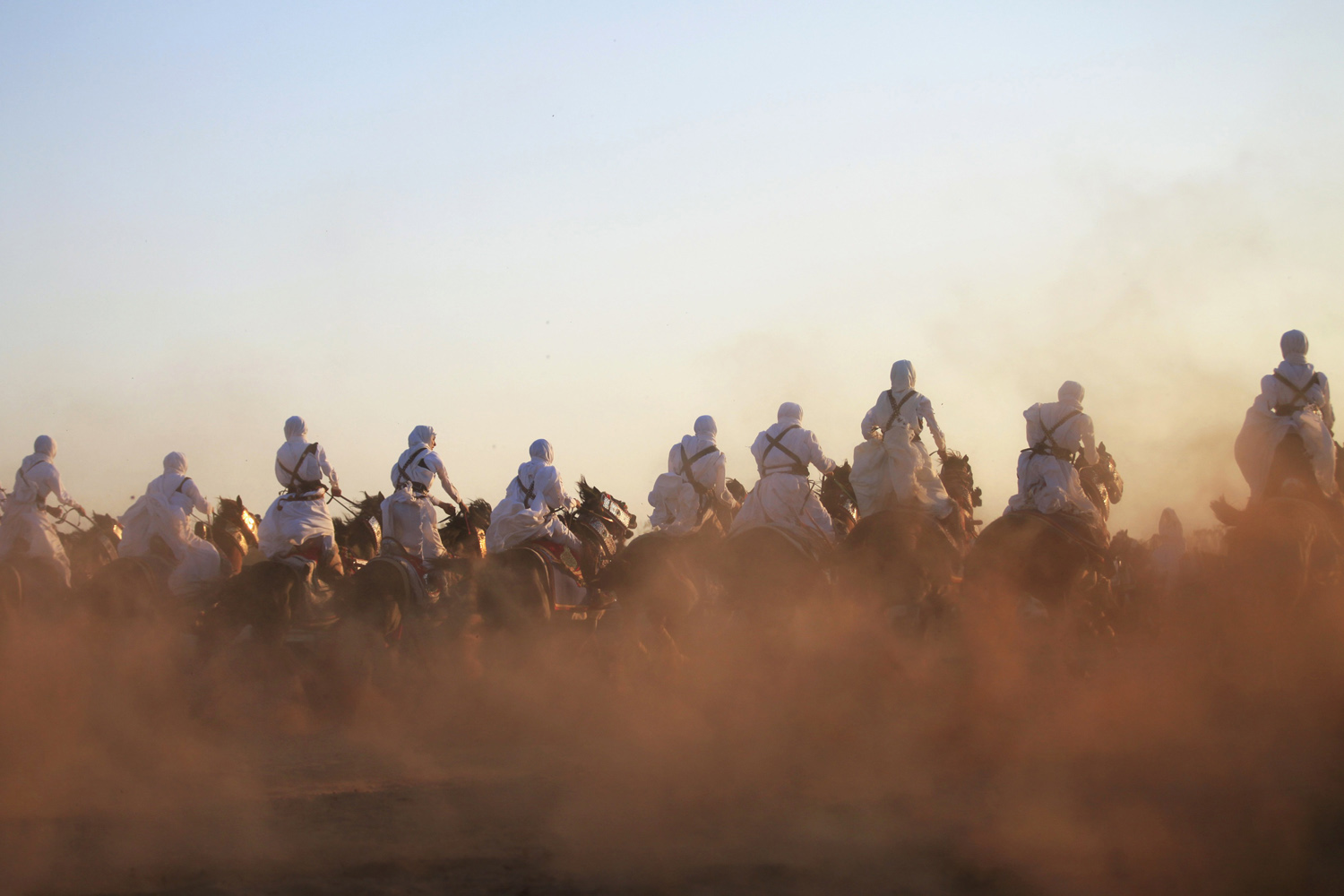 Aug. 9, 2013. Men, dressed in folk costumes, ride on horses during Eid al-Fitr, which marks the end of the holy month of Ramadan, in Benghazi, Libya.