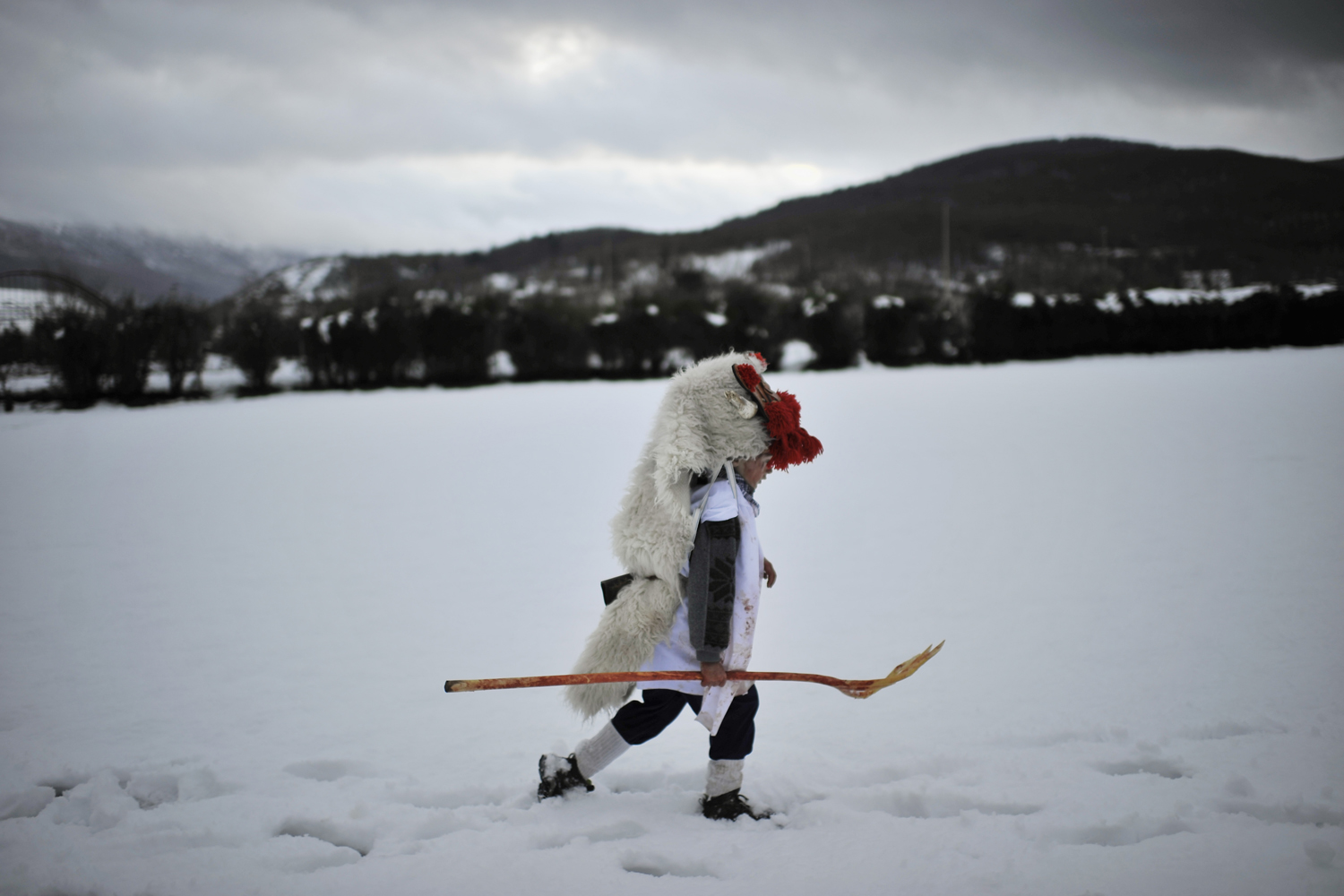 Feb. 12, 2013. A boy dressed up as Momotxorro, a local mythical animal, walks in the snow during carnival celebrations in Alsasua, northern Spain.
