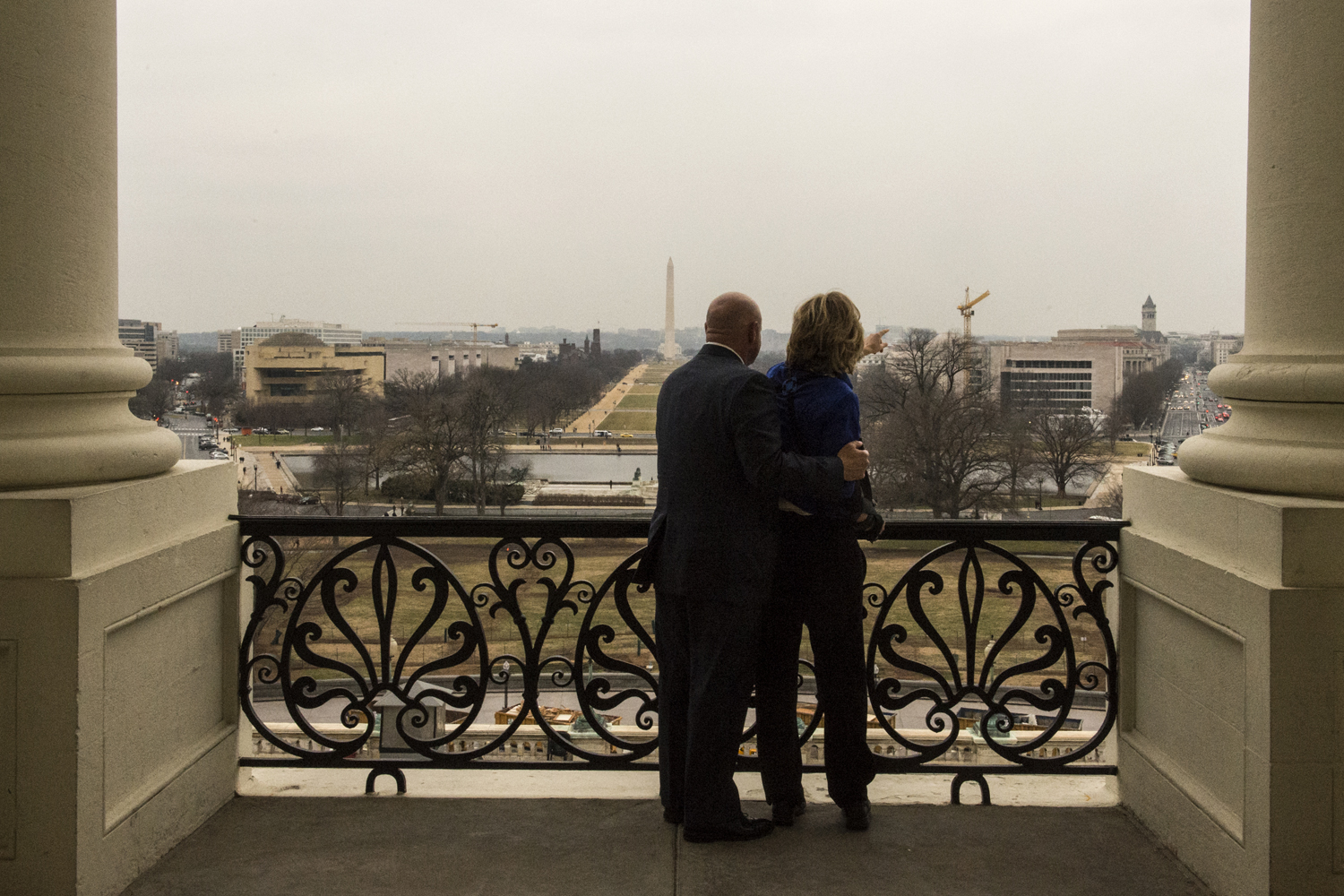 Feb. 13, 2013. Astronaut Mark Kelly and his wife former Congresswoman Gabrielle Giffords look out at the view from the Speaker's balcony while making the rounds to talk about the issue of gun violence on Capitol Hill in Washington, D.C.