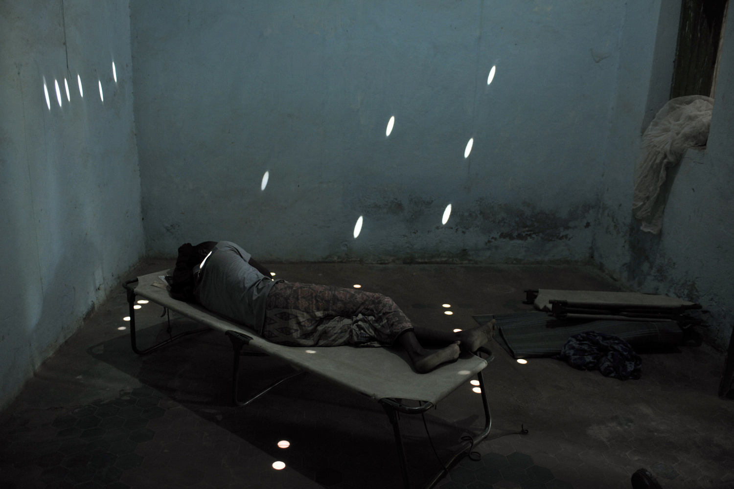 Feb. 19, 2013. A soldier from the Somali National Army (SNA) lies on a bed at an SNA infirmary in Belet Weyne, about 315 km (196 miles) from the capital Mogadishu, Somalia in this handout photo.