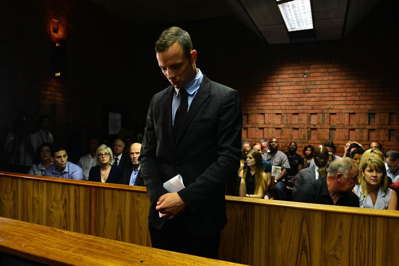 Feb. 20, 2013. Oscar Pistorius enters the court room during the second day of Oscar Pistorius bail application at Pretoria Magistrates Court, Pretoria, South Africa.