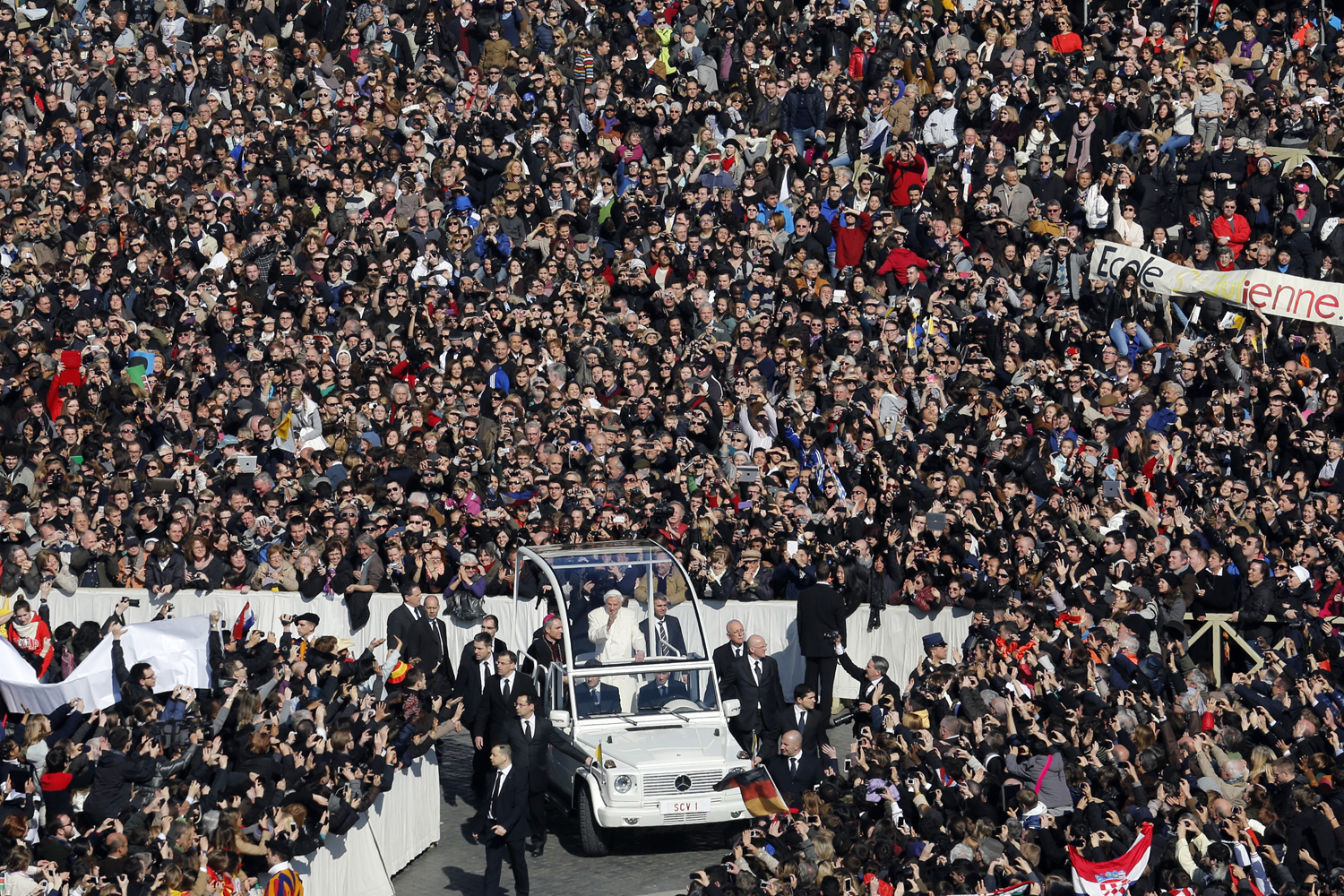 Feb. 27, 2013. Pope Benedict XVI waves from his Popemobile as he rides through a packed Saint Peter's Square at the Vatican during his last general audience.