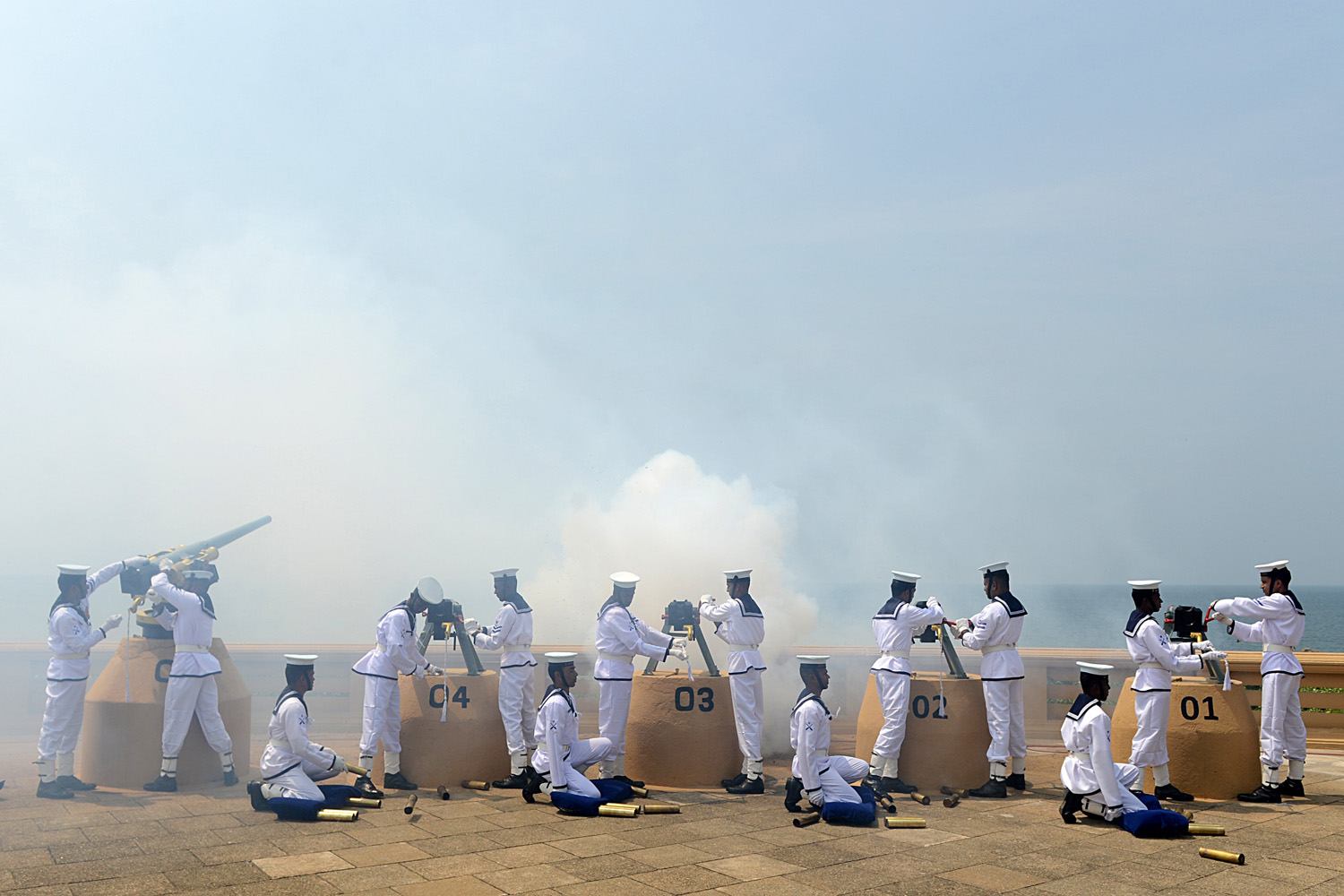 Feb. 4, 2013. Sri Lankan Navy personnel fire a 21-gun salute on the capital's seafront Galle Face promenade to mark the island nation's 65th Independence Day in Colombo.