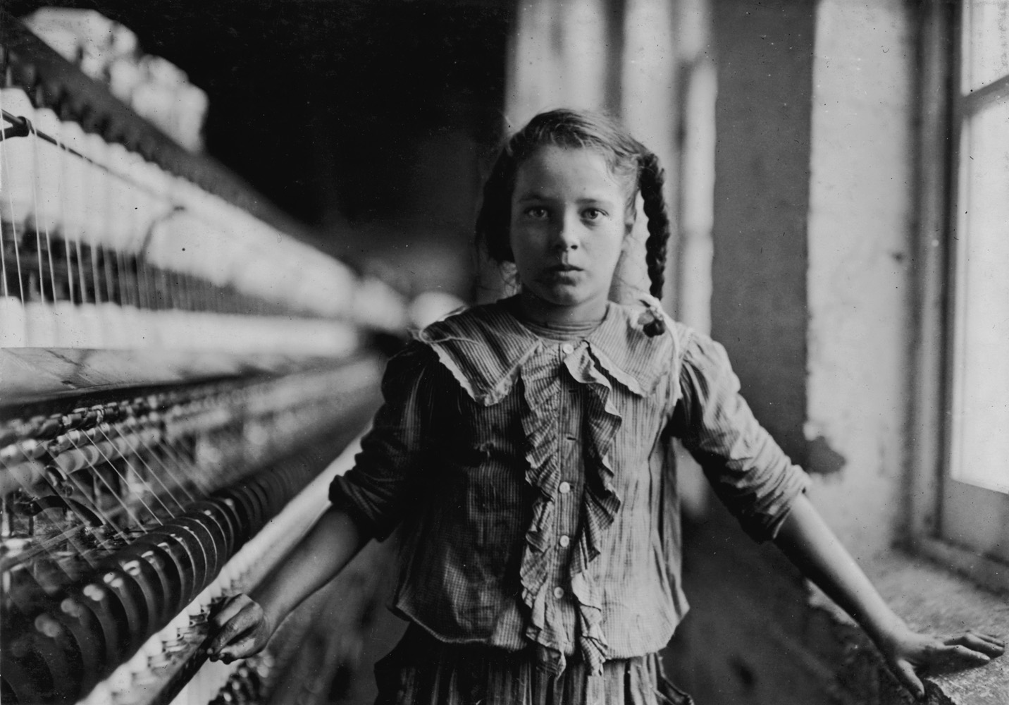 "Cora Lee Griffin, spinner in cotton mill, 12 years old, Whitnel, North Carolina, 1908.                                 One of the spinners in Whitnel Cotton Mfg. Co. N.C. She was 51 inches high. Had been in mill 1 year. Some at night. Runs 4 sides, 48 cents a day. When asked how old, she hesitated, then said  I don't remember.  Then confidentially,  I'm not old enough to work, but I do just the same.  Out of 50 employees, ten children about her size. —Hine's original caption                               ""She had regrets about not getting the education she had desired. She only got as far as the sixth grade. At that point, she started working full time. But she wanted an education, and really valued it, and it was a priority for her that we got a good education— whatever it took to send us to college."" —Daughter of Cora Lee Griffin"