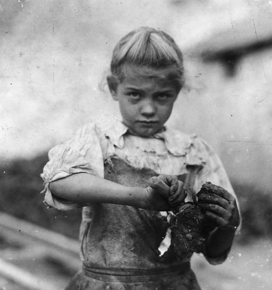 "Rose Berdych, oyster shucker, seven years old, Bluffton, South Carolina, 1913. 7-year old Rosie. Regular oyster shucker. Her second year at it. Illiterate. Works all day. Shucks only a few pots a day. (Showing process) Varn & Platt Canning Co.  —Hine's original caption""She used to talk about when she was young and they traveled from Baltimore to South Carolina and then back to Baltimore to pick fruits and vegetables. I know that she grew up in Baltimore. They were poor, and they lived in a tenement house. She never talked about going to school. We always wondered how she learned to read and write.  —Daughter of Rose Berdych"