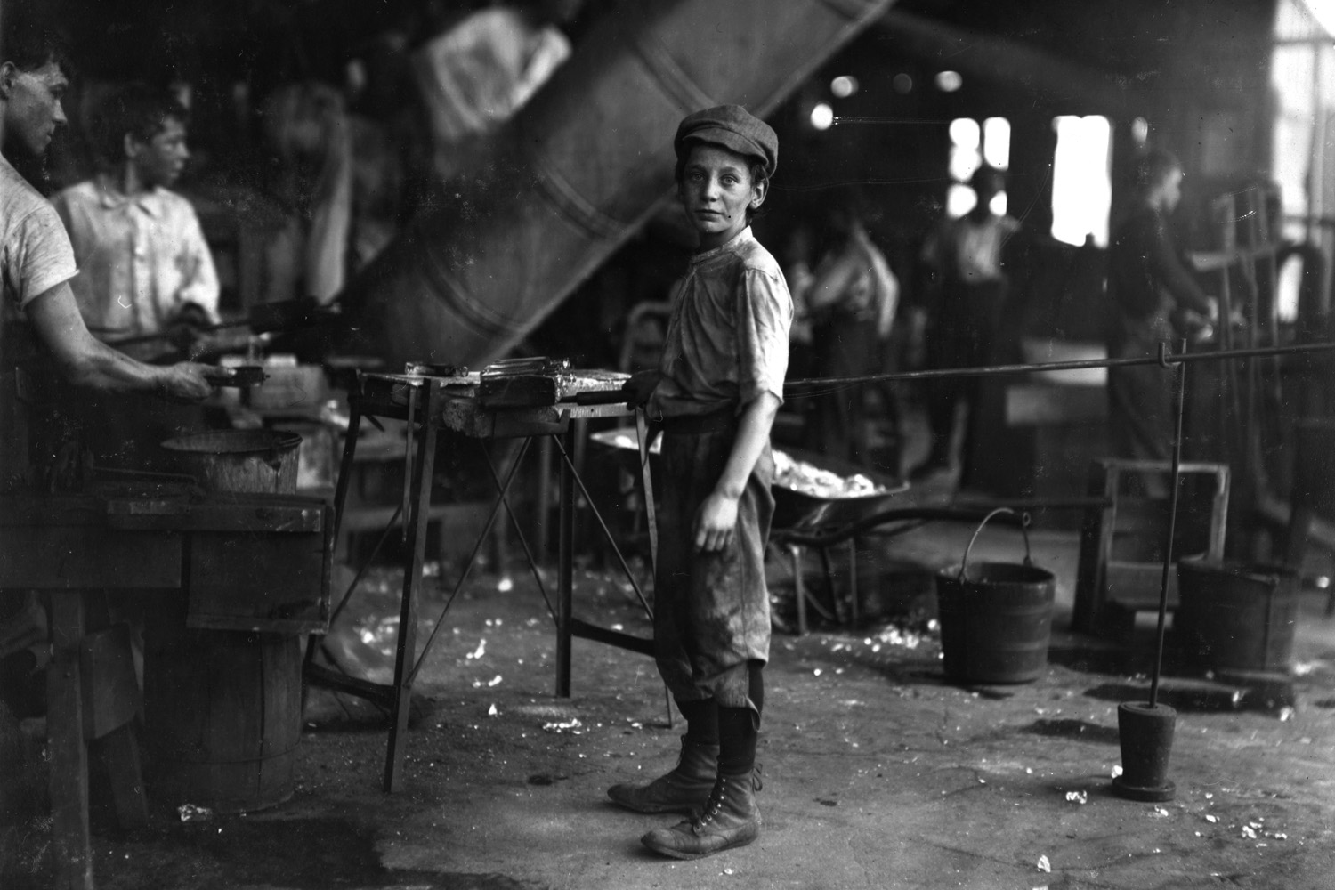 "Each of the following slides contain Manning's field notes on his subjects, whether quotes from their descendents or facts he uncovered about their lives. We've also included Hine's original captions when available. Click on the subject's name to view Manning's full research.Robert Kidd, glass factory worker, 12 years old, Alexandria, Virginia, 1911.                                               'Carrying-in' boy in Alexandria Glass Factory. Works on day shift one week and night shift next week.  —Hine's original caption                                              ""He always had that [sad] expression. I take after him, because everybody tells me I look the same way, sad all the time. He was an alcoholic, but I loved my father. He wasn't mean. He was a good father, other than the sickness he had with alcohol. He was always good to us. I remember one time when I was sick, he brought me some oranges. He loved his children. He was always concerned about us."" —Daughter of Robert Kidd"