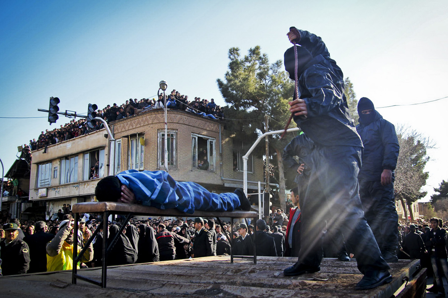 Jan. 16, 2013. An Iranian officer lashes a man, convicted of rape, at the northeastern city of Sabzevar, Iran.