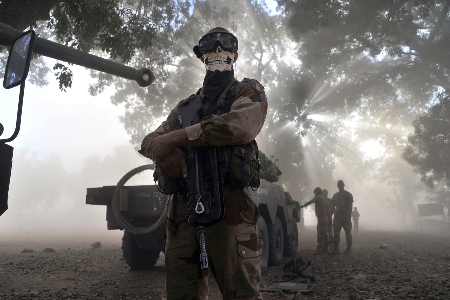 Jan. 20, 2013. A French soldier wearing a skeleton mask stands next to a tank on a street in Niono, Mali.