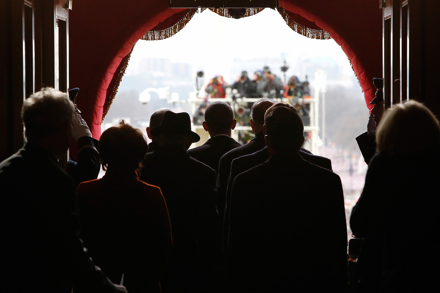 Jan. 21, 2013. U.S. President Barack Obama (C) pauses with his escorts before walking through the Lower West Terrace Door of the US Capitol to begin swearing-in ceremonies in Washington.