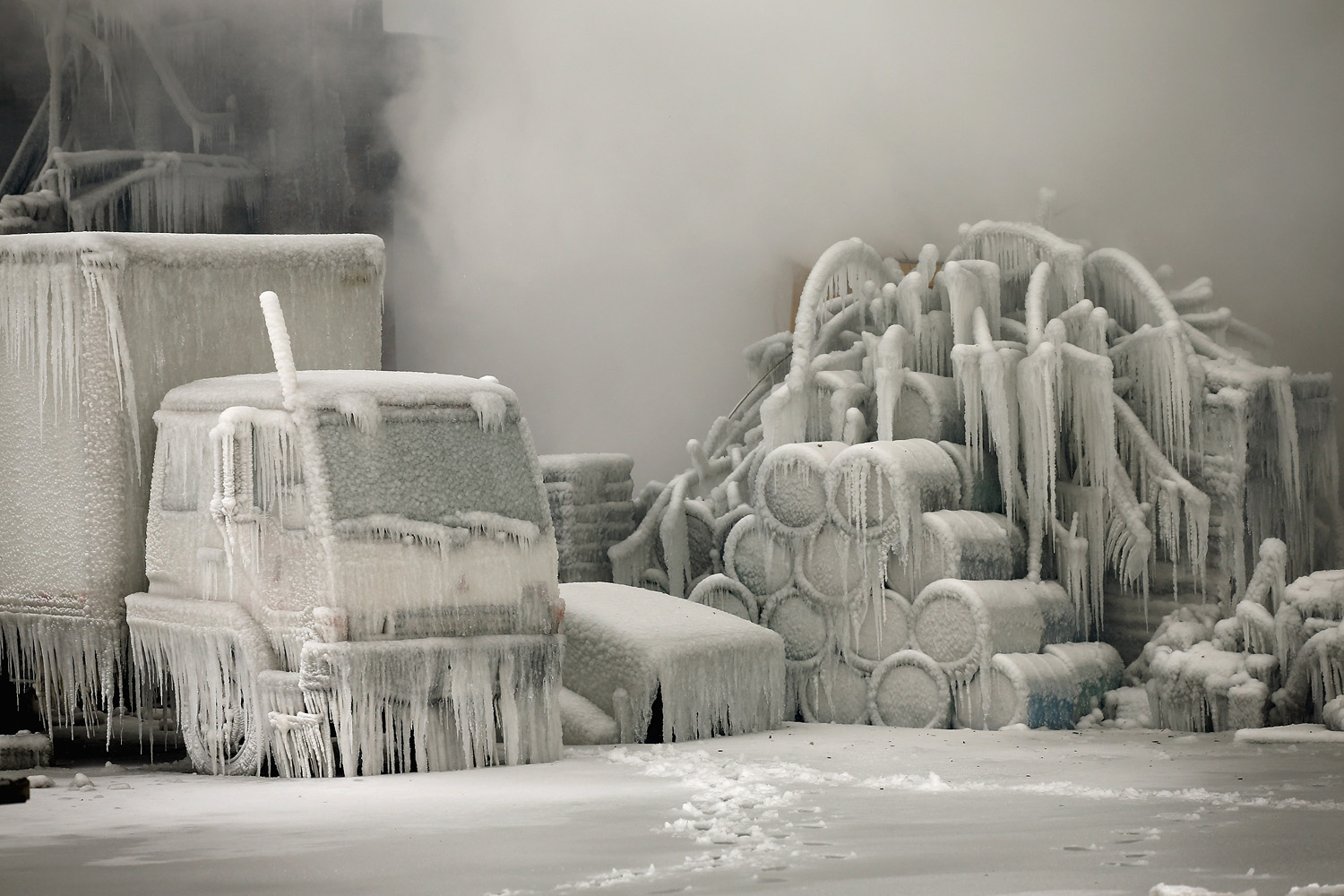 Jan. 23, 2013. A truck is covered in ice as firefighters help to extinguish a massive blaze at a vacant warehouse in Chicago, Ill.