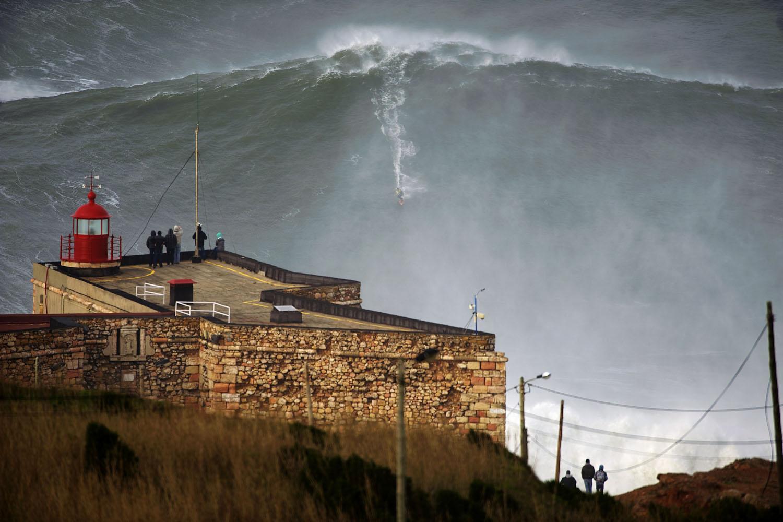 Jan. 28, 2013. US surfer Garrett McNamara rides a wave off Praia do Norte beach in Nazare, Portugal.