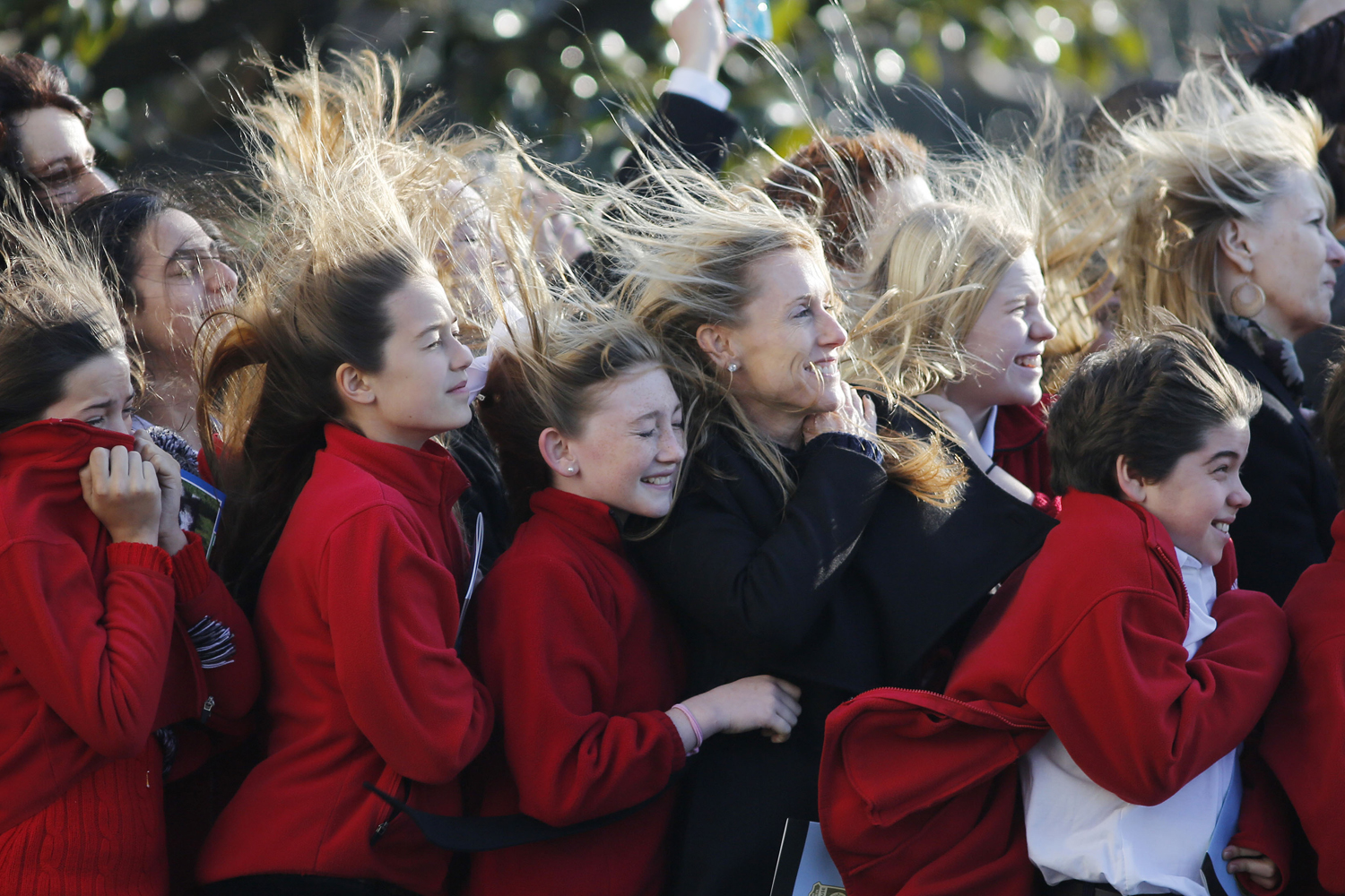 Jan. 29, 2013. Sixth grade students from the Park Maitland School in Maitland, Florida, watch as Marine One carrying U.S. President Barack Obama takes off from the South Lawn at the White House in Washington as he departs for Las Vegas.