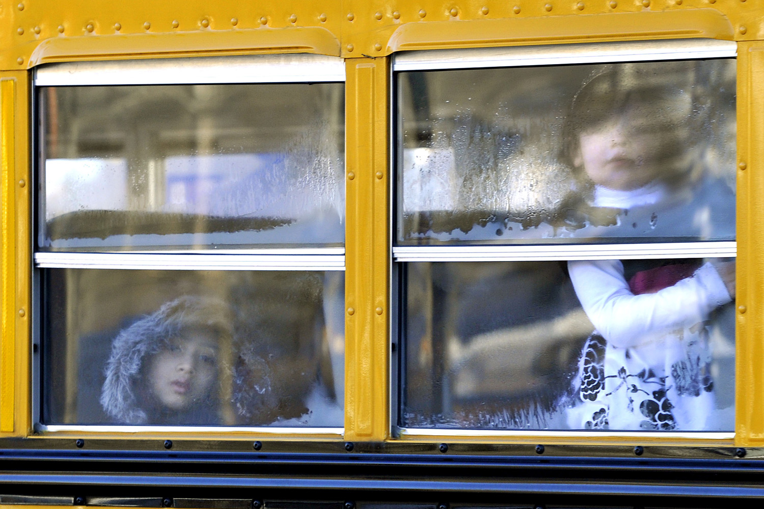 Jan. 3, 2013. Sandy Hook Elementary students leave on a school bus  in Newtown, Connecticut.