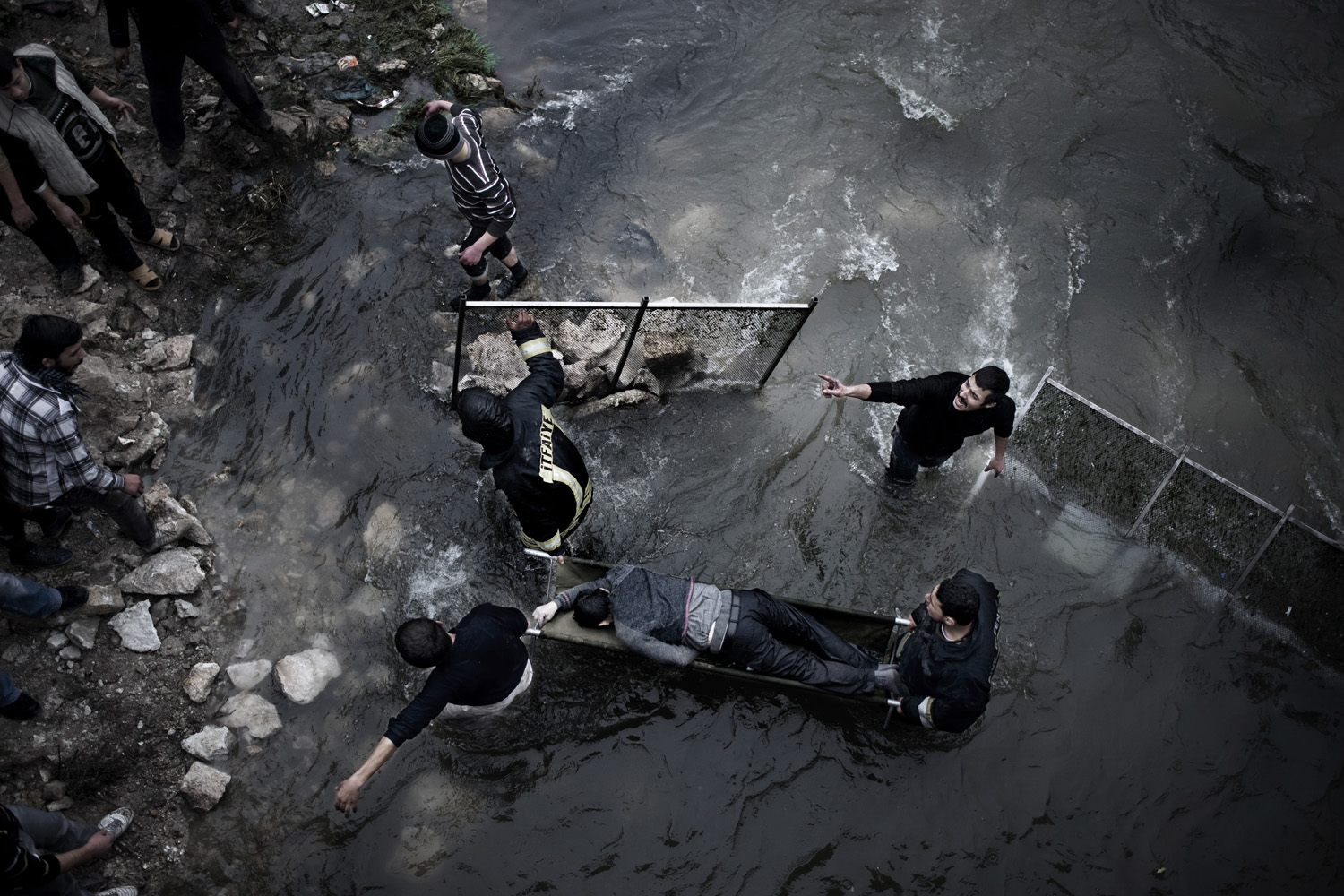 Jan. 30, 2013. Bodies float down a stream in Aleppo, Syria, more than 24 hours after a massacre.