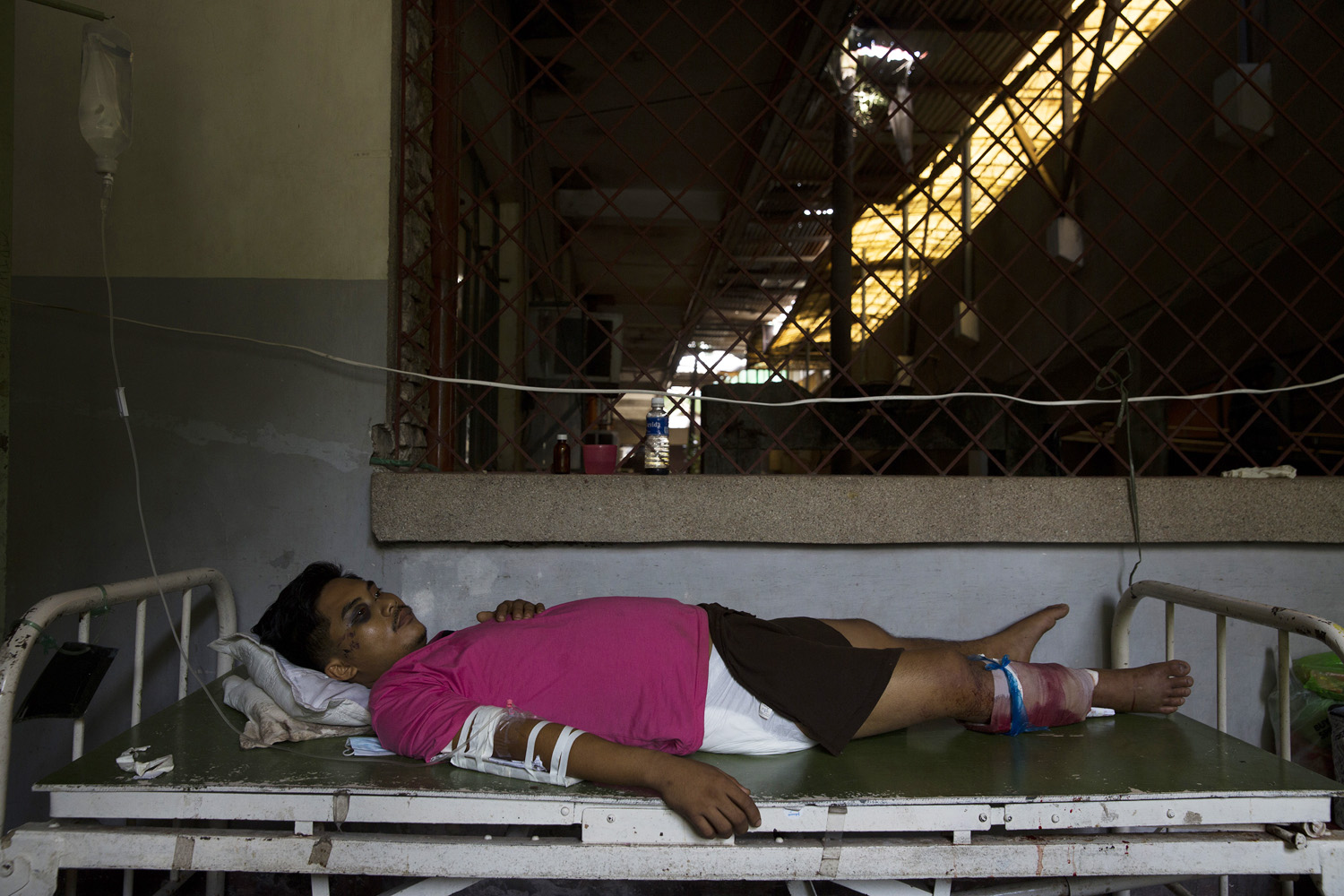 Richard Pulga lies in a hospital in Tacloban, Nov. 13, 2013. Two days later, he died of his wounds after not receiving proper medical attention.