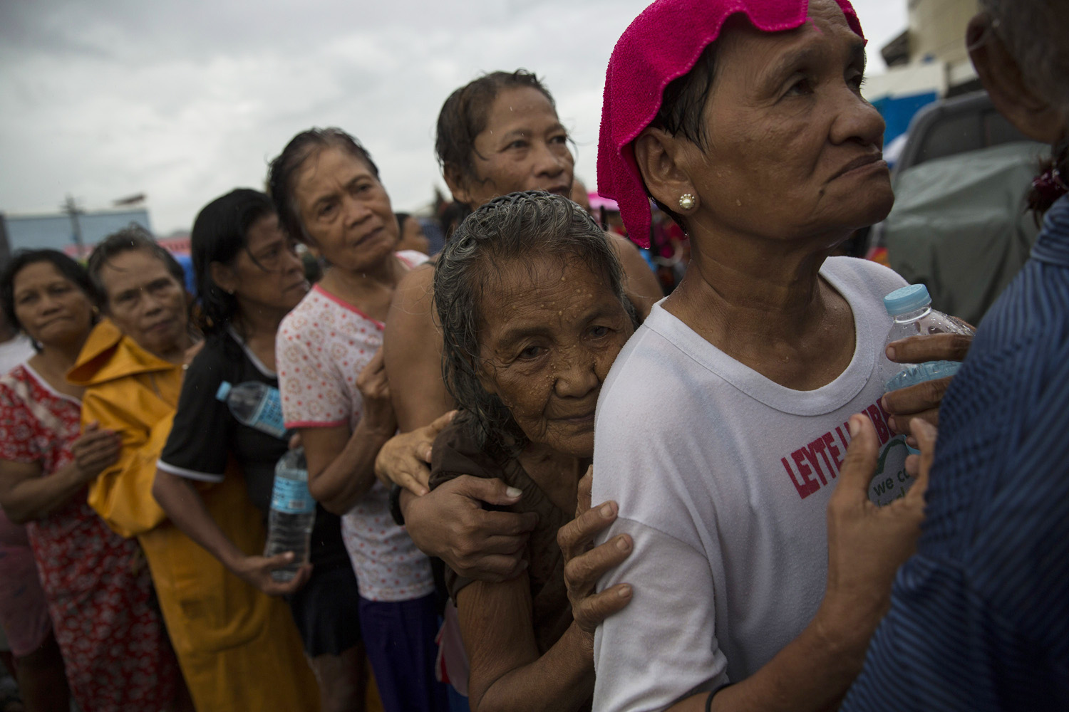 At a displacement camp in Tacloban, refugees wait for aid to be distributed, Nov. 14, 2013.