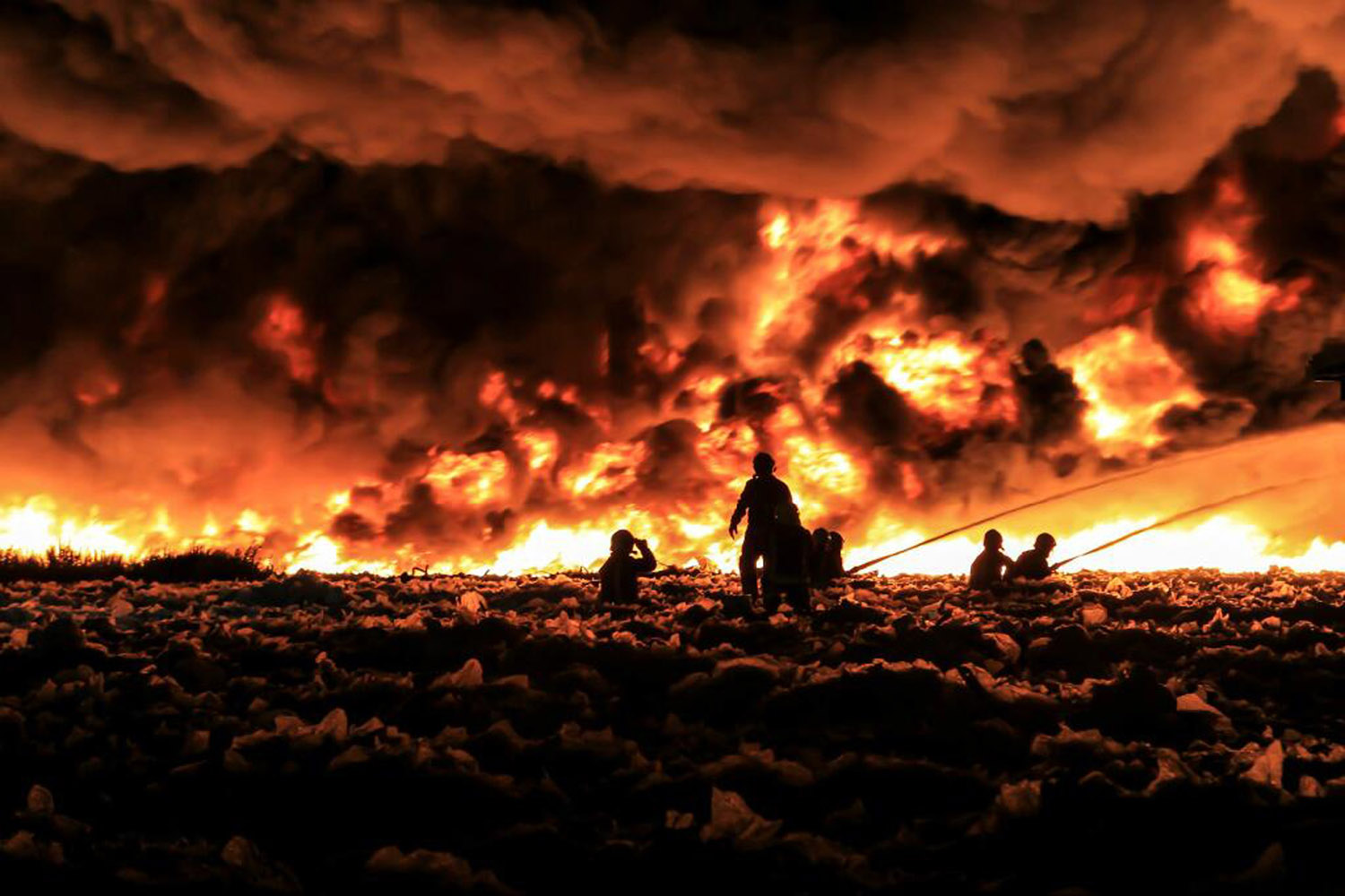 July 1, 2013. Firefighters tackle a large blaze at a recycling center in Smethwick, near Birmingham, central England in a handout picture provided by the West Midlands Fire Service.