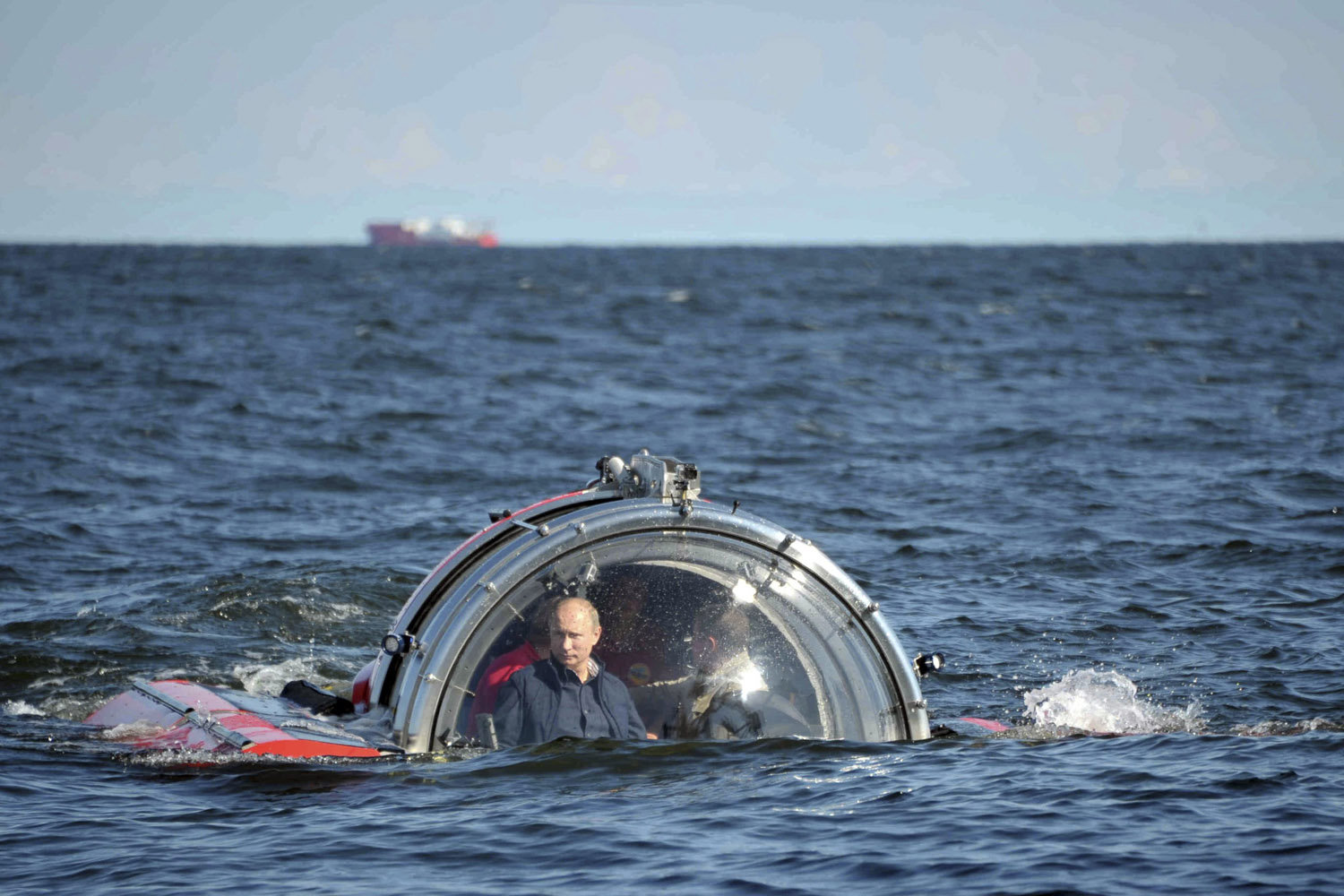 July 15, 2013. Russia's President Vladimir Putin (L) is seen through the glass of C-Explorer 5 submersible after a dive to see the remains of the naval frigate  Oleg.  which sank in the 19th century, in the Gulf of Finland in the Baltic Sea.