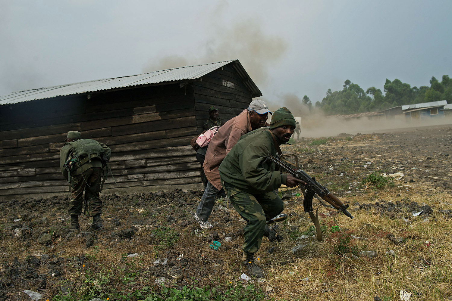 July 17, 2013. Congolese army soldiers react to shelling in Kanyarucinya, around 10km from Goma in the east of the Democratic Republic of the Congo.