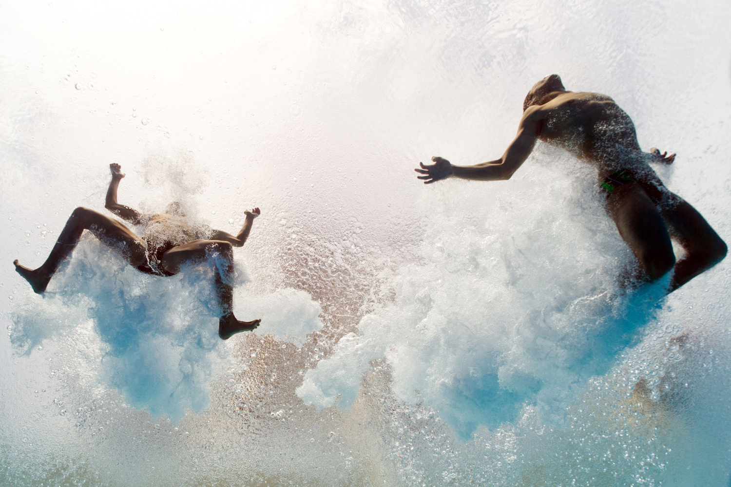 July 21, 2013. Mexico's Ivan Garcia and German Sanchez enter the water as they compete in the men's 10-meter synchro platform preliminary diving event in the FINA World Championships at the Piscina Municipal de Montjuic in Barcelona, Spain.