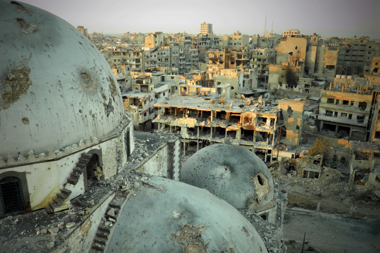 July 25, 2013. A handout image released by the Syrian opposition's Shaam News Network allegedly shows the Khaled bin Walid mosque whose mausoleum has been partially destroyed in the al-Khalidiyah neighborhood of the central Syrian city of Homs.